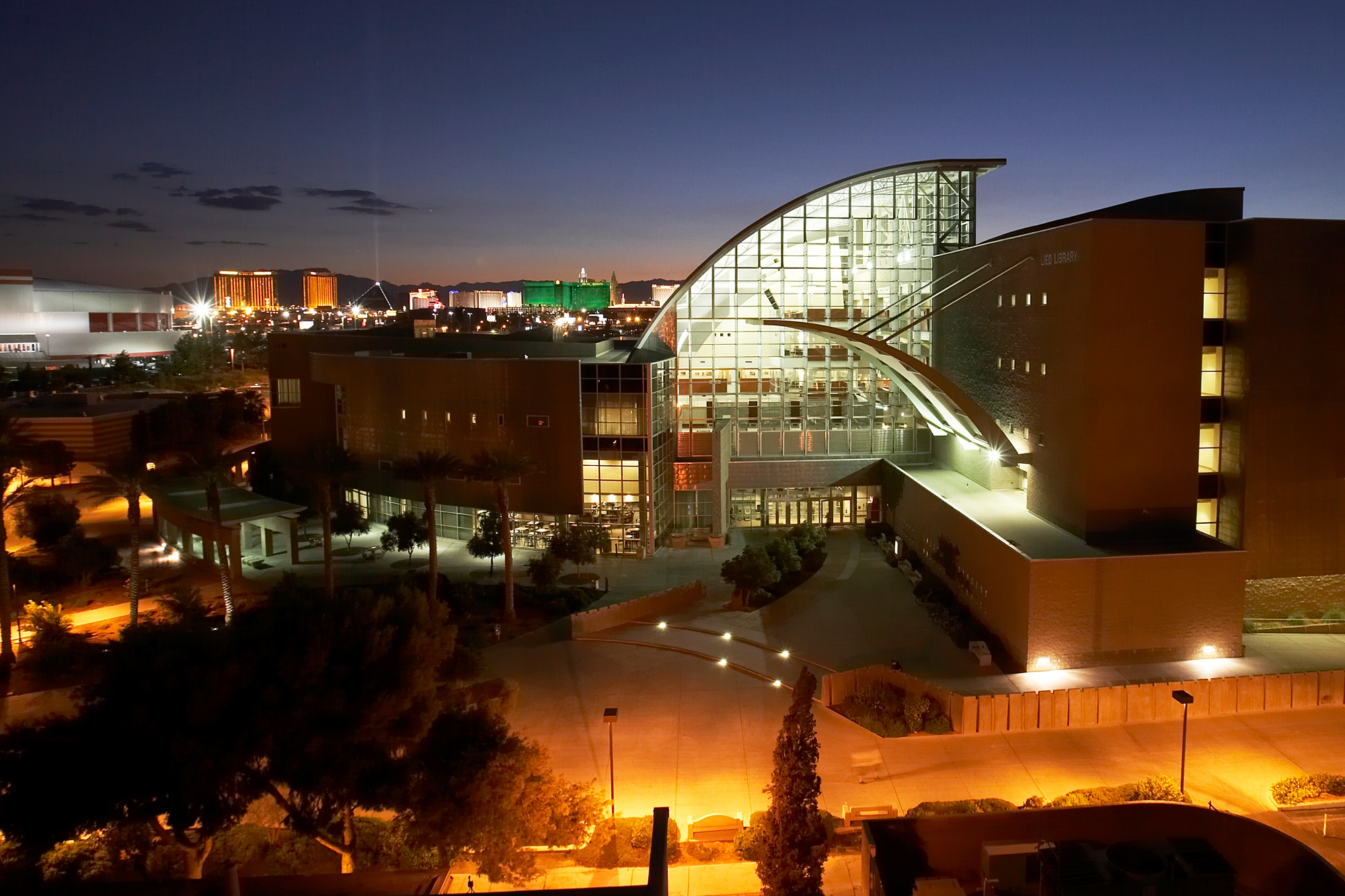Night time shot of Lied Library at the University of Nevada, Las Vegas, with the Las Vegas Strip in background.